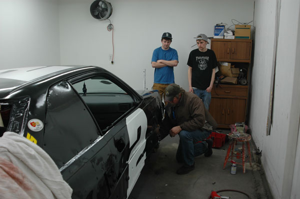 race crew at work on road runner car